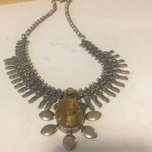 Beautiful ethnic necklace with Tiger eye pendant.